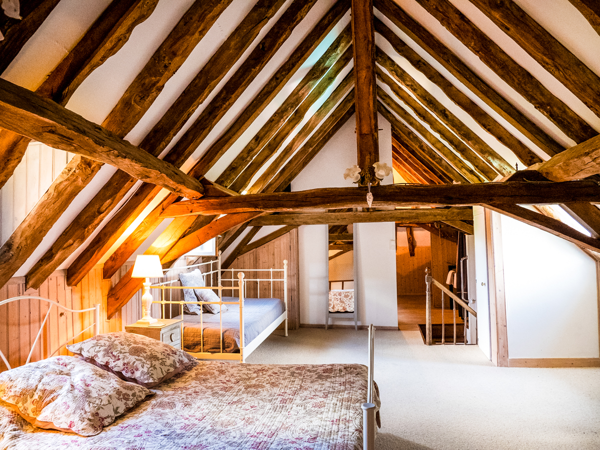 La Chataigne spacious 2nd floor family bedroom (1 double bed, 2 single beds) in the eves of the old farmhouse with shower en-suite