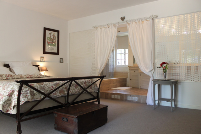La Grange ground floor refurbished supering bedroom with en-suite bathroom and wisteria clad terrace.